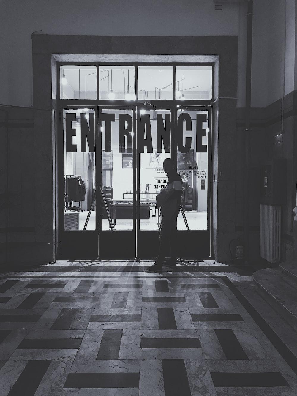 man standing near the door of the building