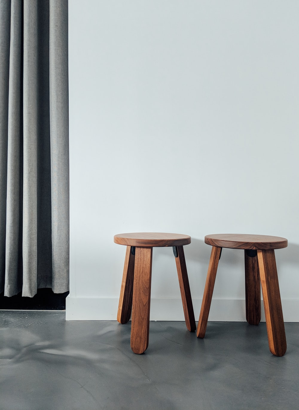 two brown wooden stools