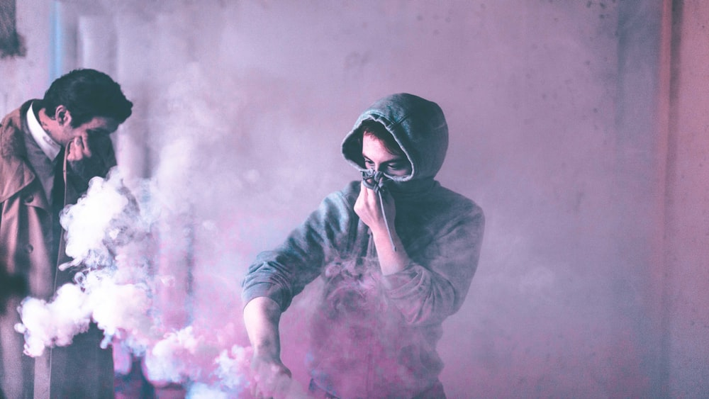 scattered smoke inside room with man and woman covered their nose