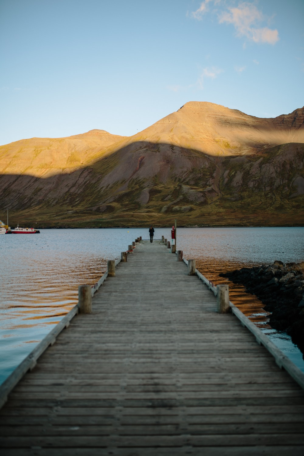person standing at edge of dock