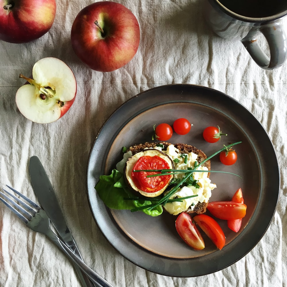 sandwich with cream and tomatoes on plate