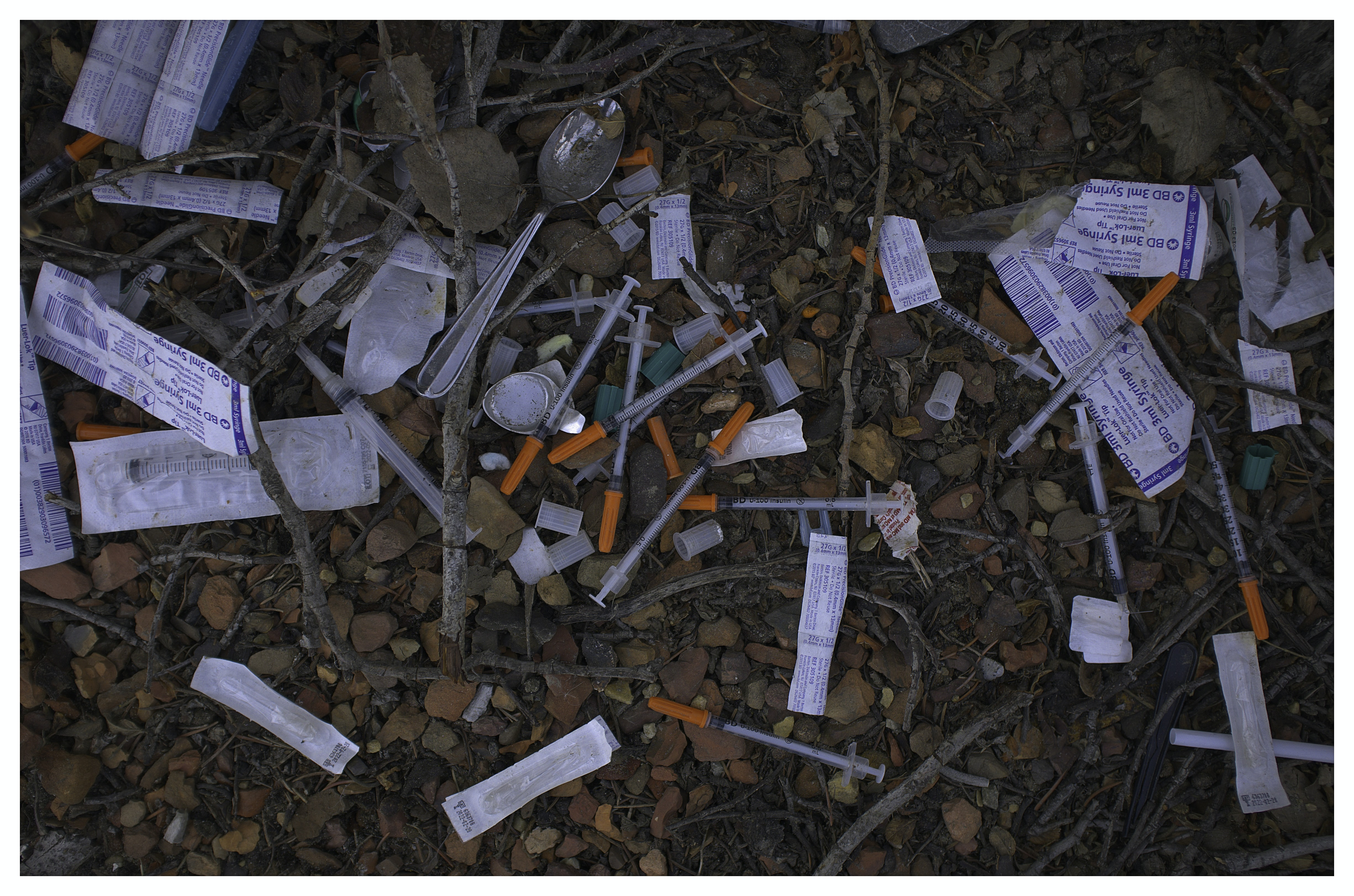 syringes on ground