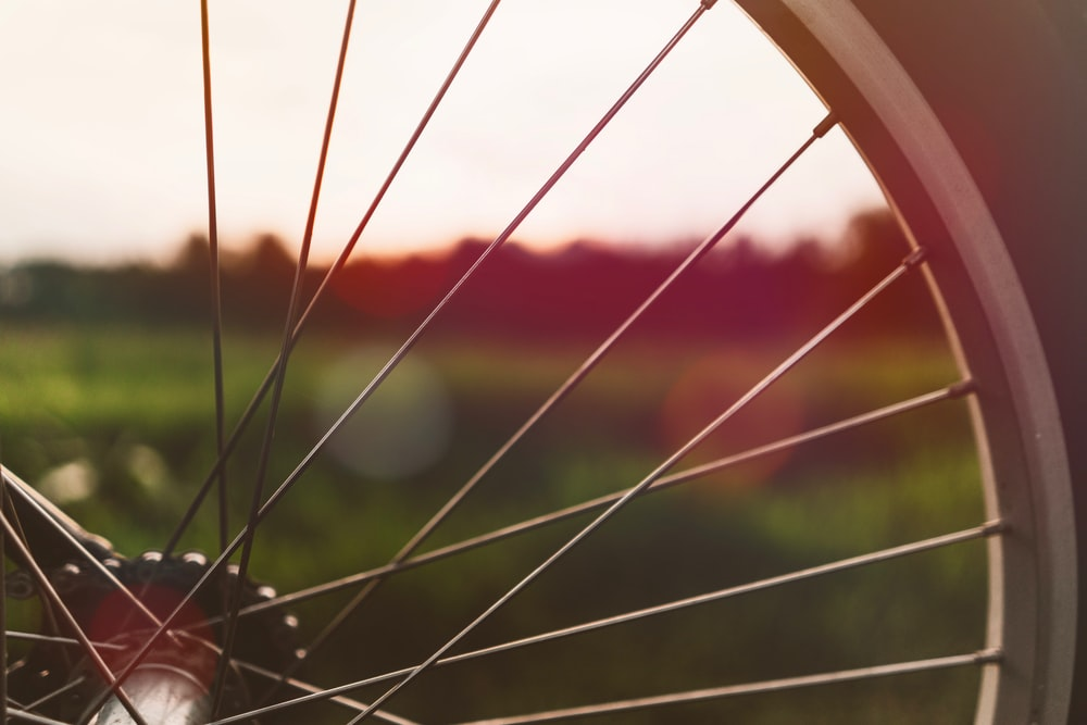 closeup photography of bicycle wheel
