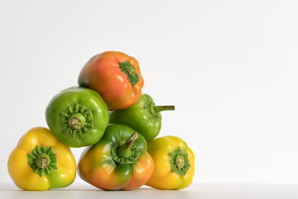 green, yellow, and orange bell peppers