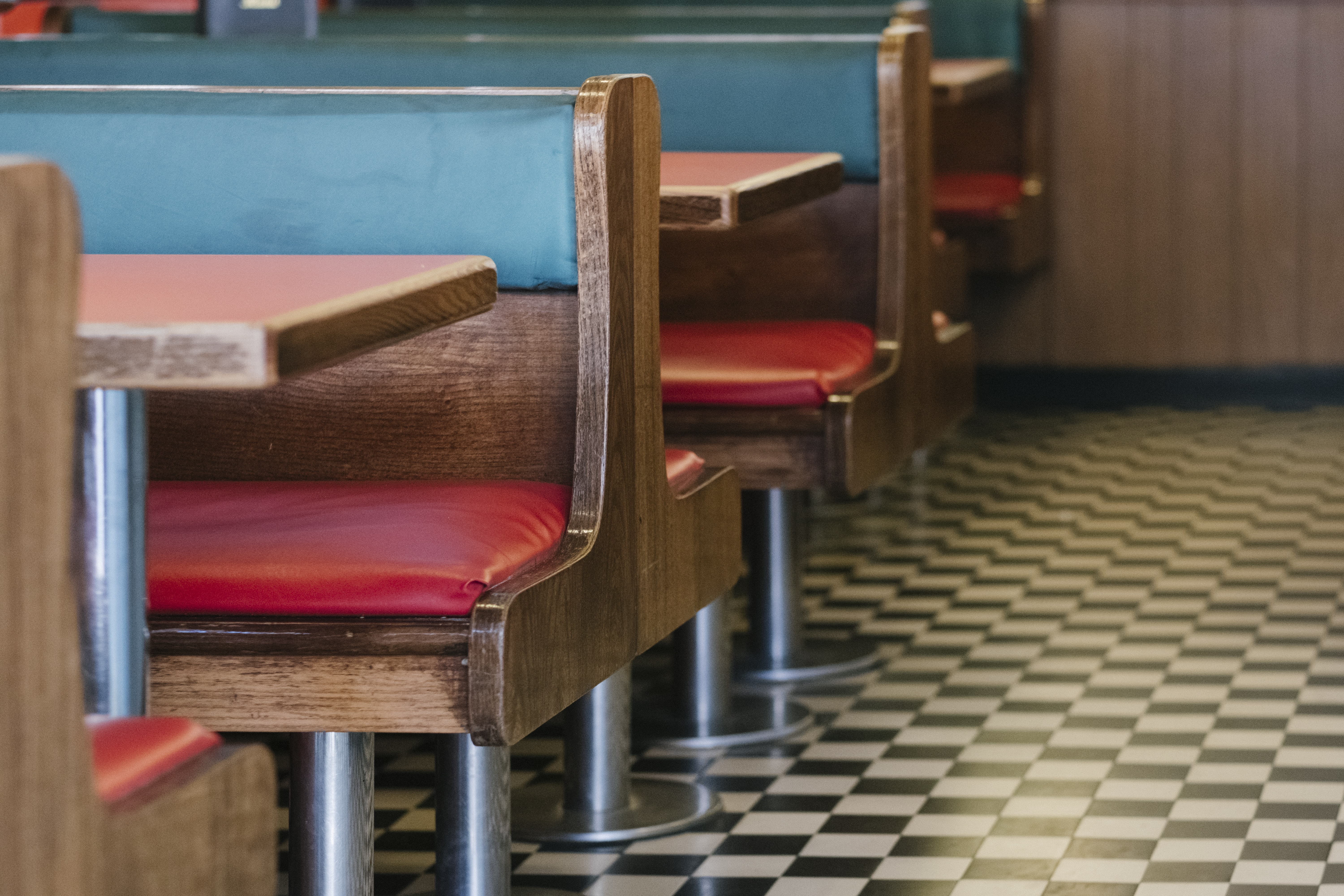 red leather padded benches in diner