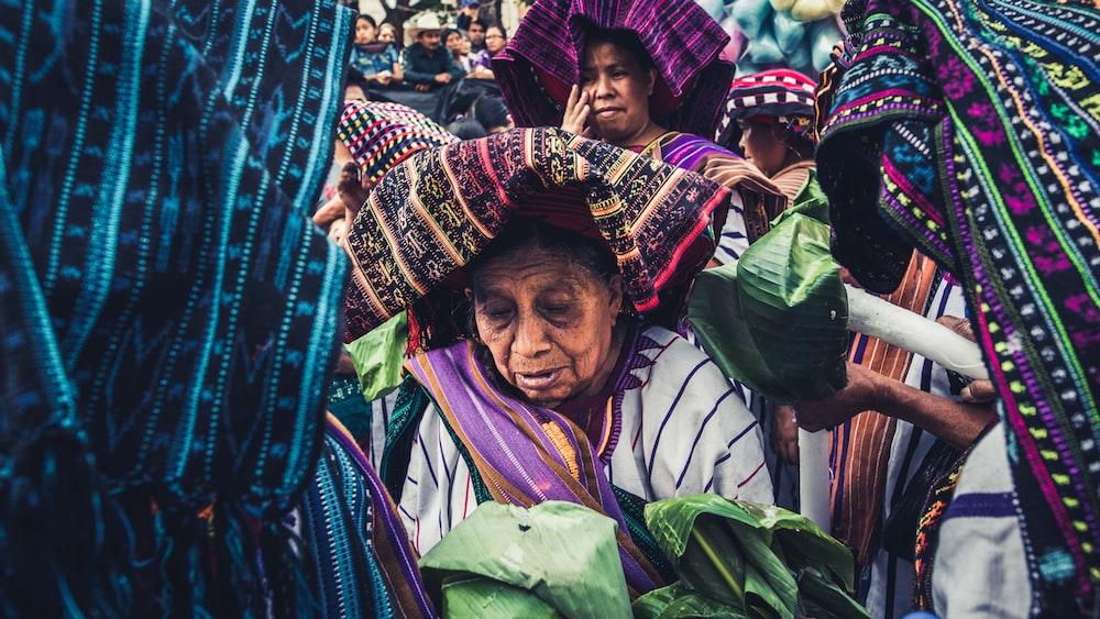 women holding green leaves