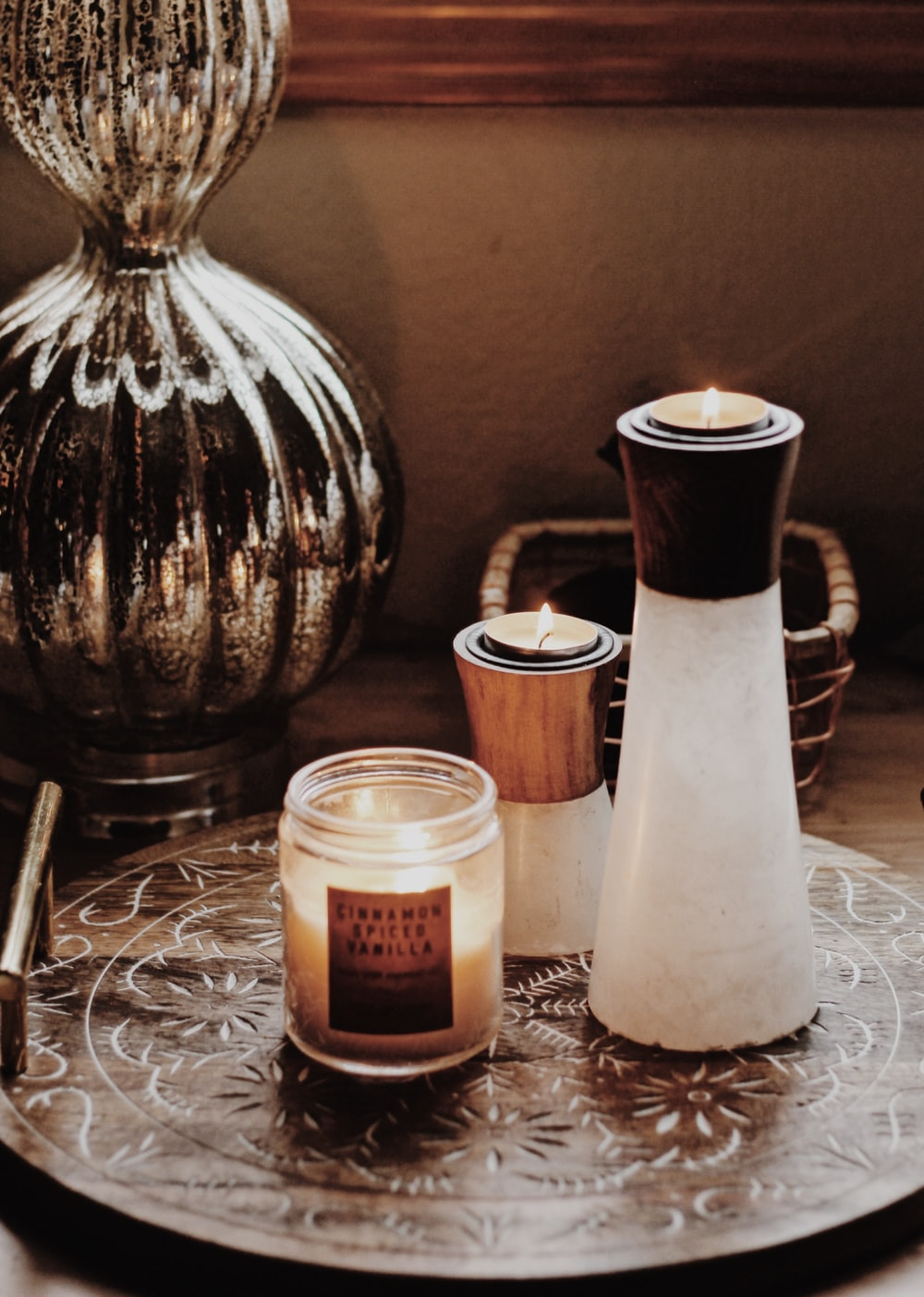 white and brown candle holders beside votive candle