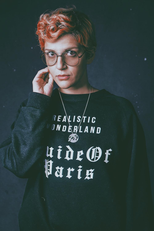 one unknown celebrity in black crew-neck sweater