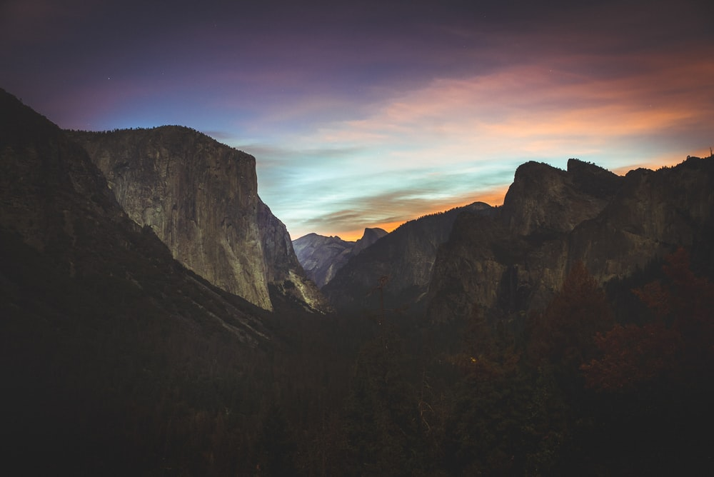grey mountains during sunset