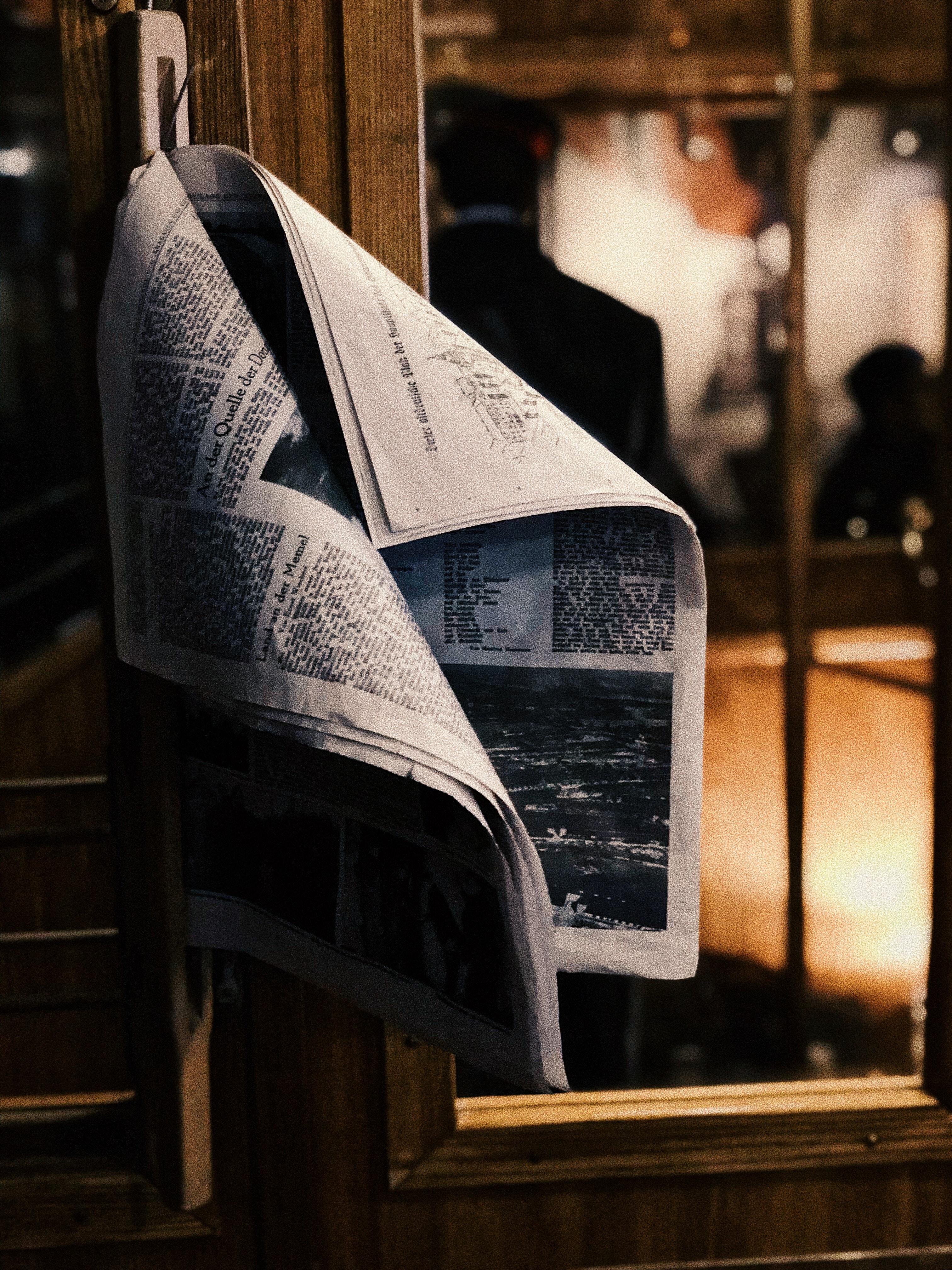 newspaper on door