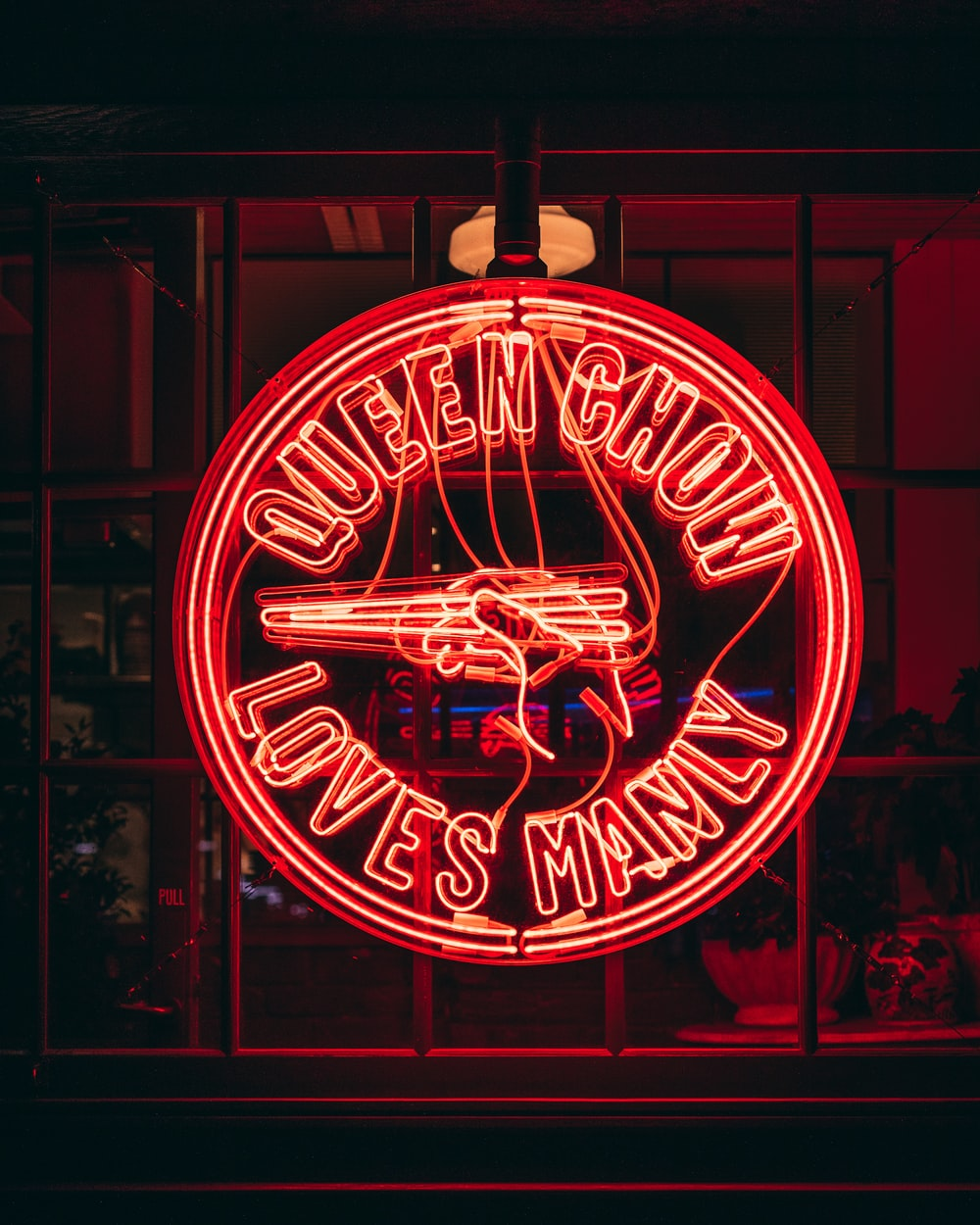 queen chow loves manly neon signage