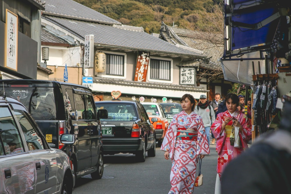 two women wearing kimonos
