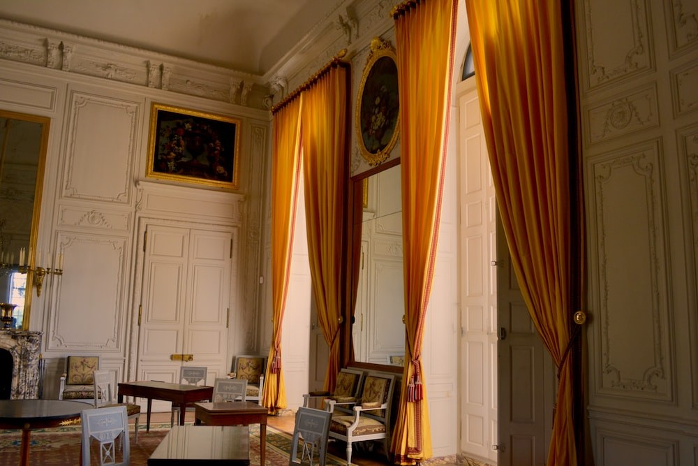 white house with yellow curtains