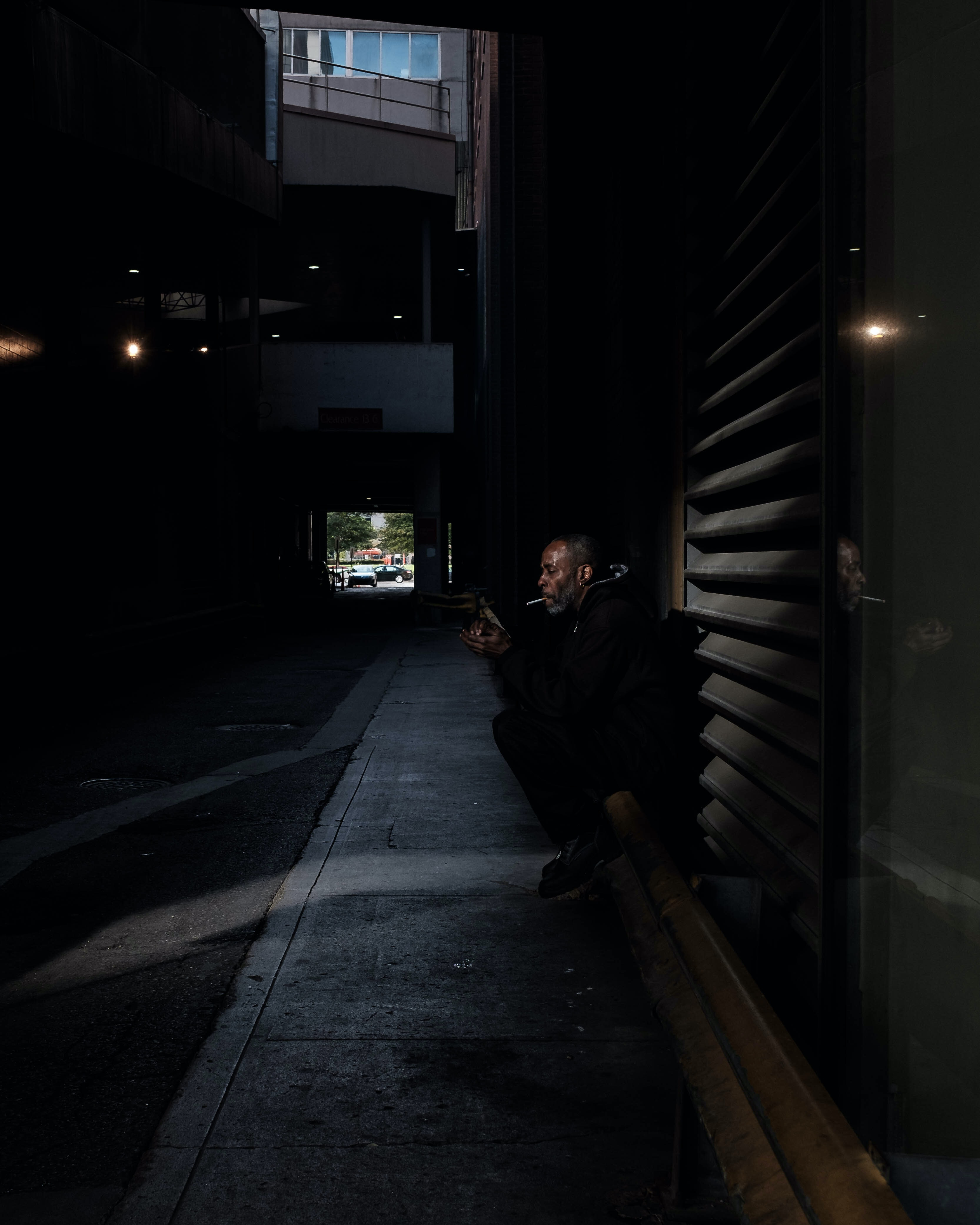 person sitting next to wall