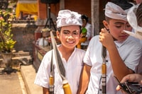 Balinese kids in traditional costume on a balinese family ceremony in desa Pejeng Kangi.