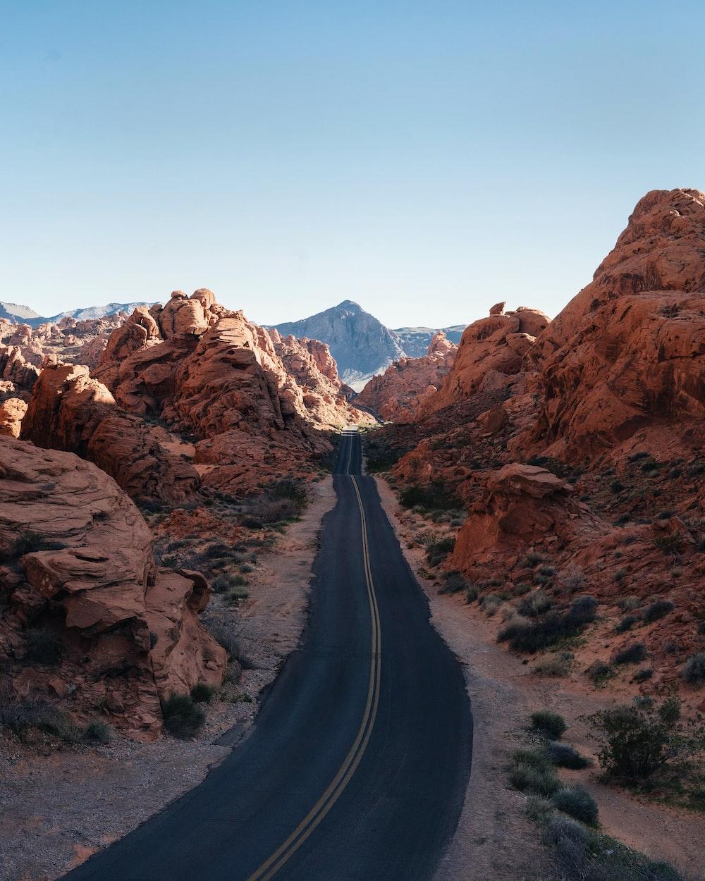 asphalt road between rocks