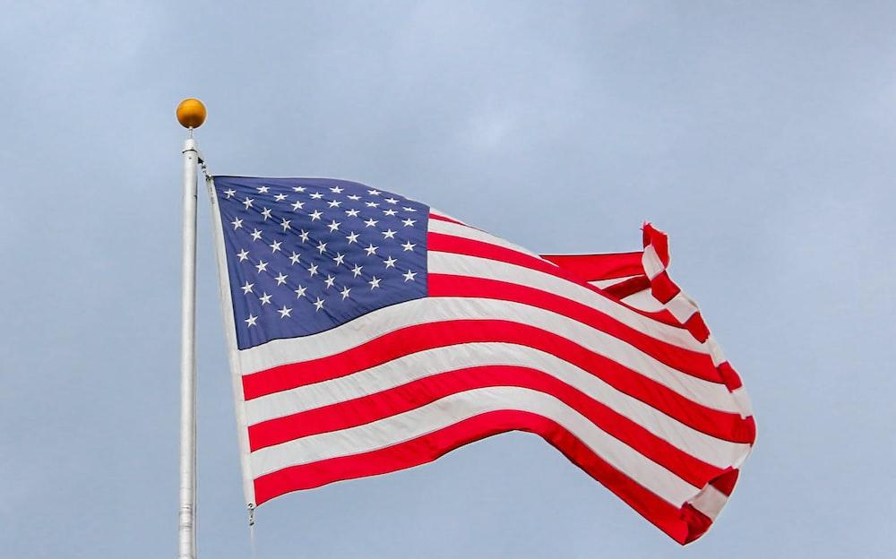 waving US flag on pole