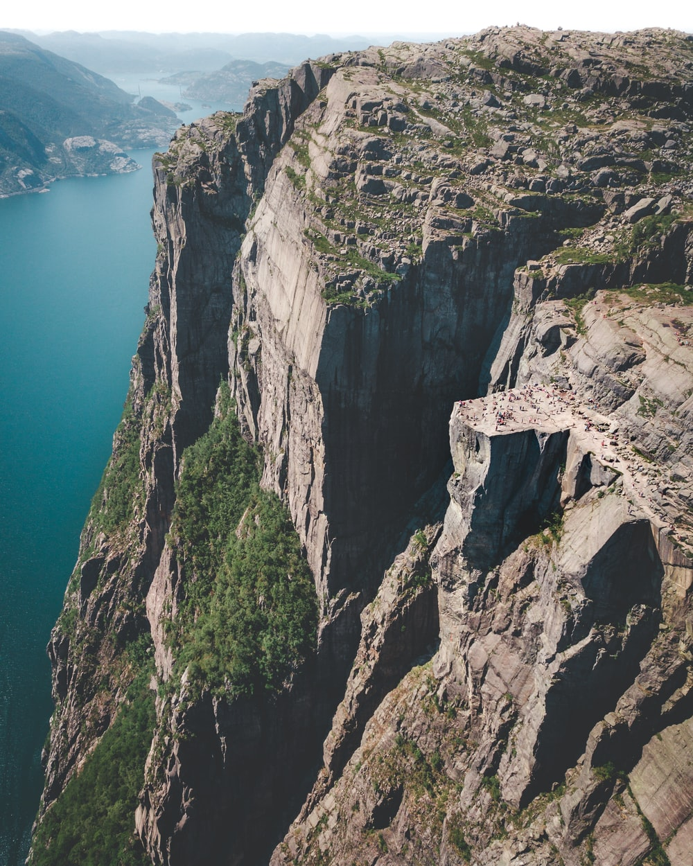cliff near body of water during daytime