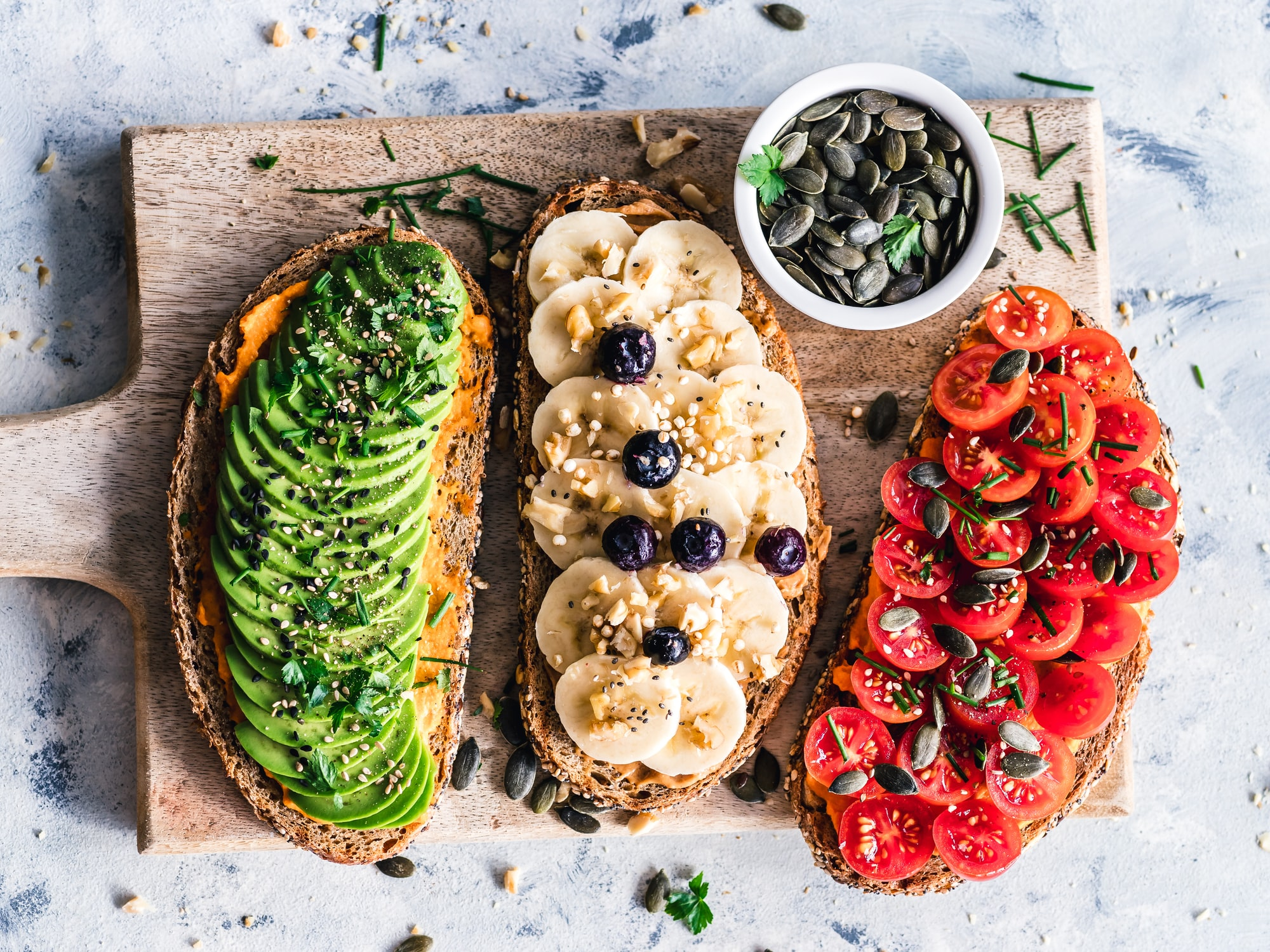 Bread toasts with avocado, banana, tomato. Easy to make, great for a quick breakfast.