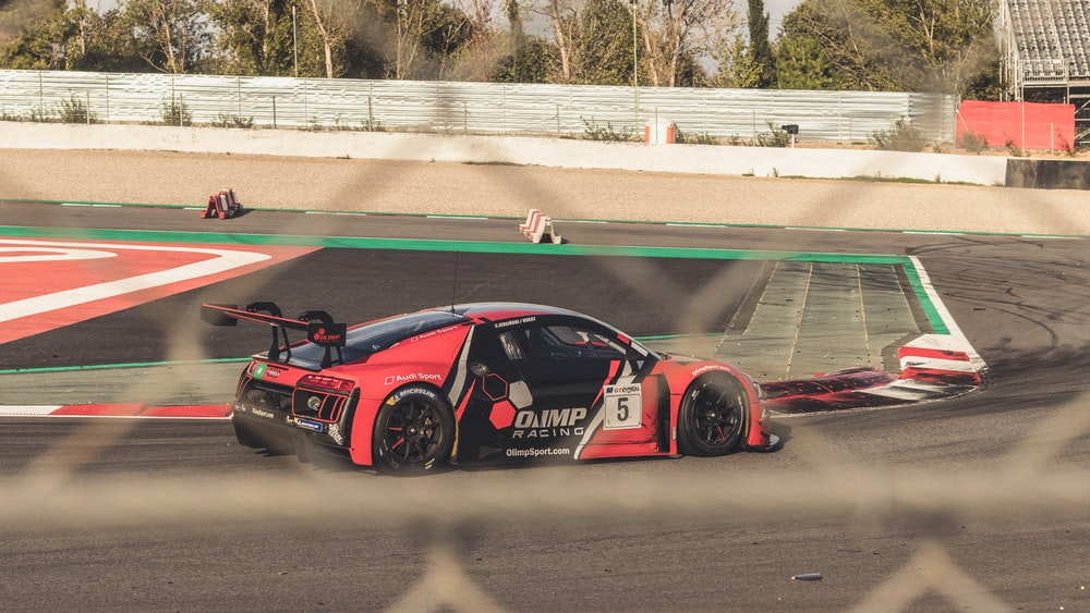 red and black Audi race car on track during daytime