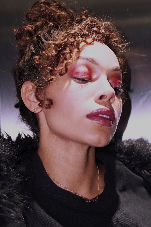 woman wearing black top and pink eyeshadow