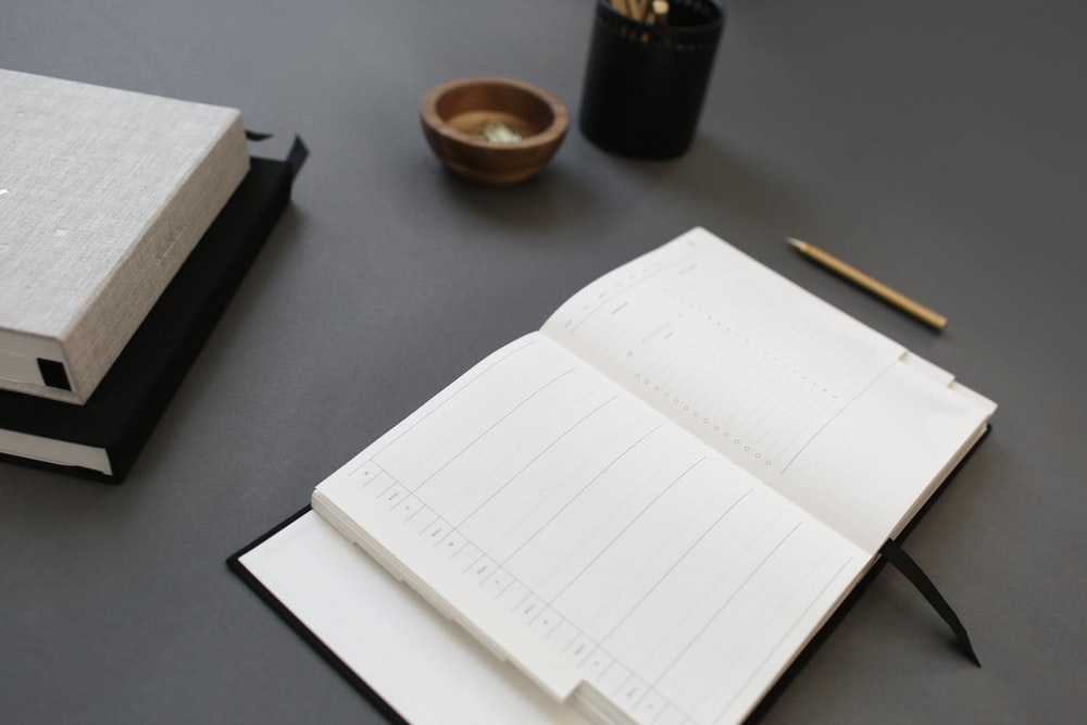 opened white notebook