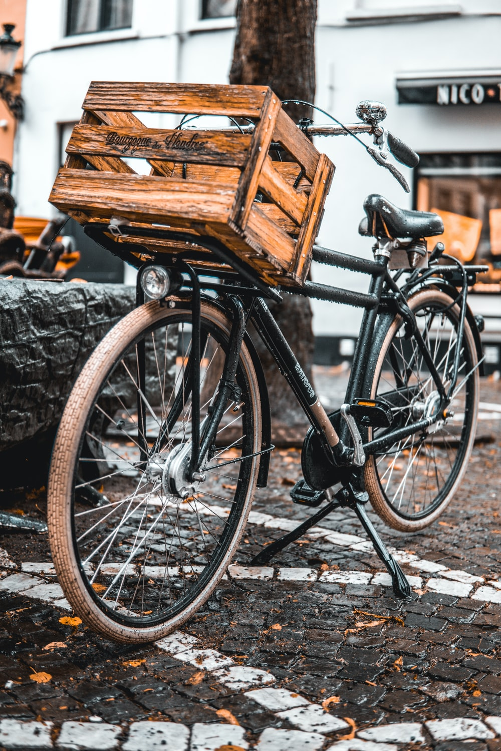 brown wooden crate on bicycle