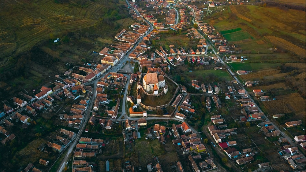 aerial photography of castle surrounded with houses during daytime