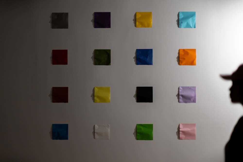 multi colored sticky notes on the wall