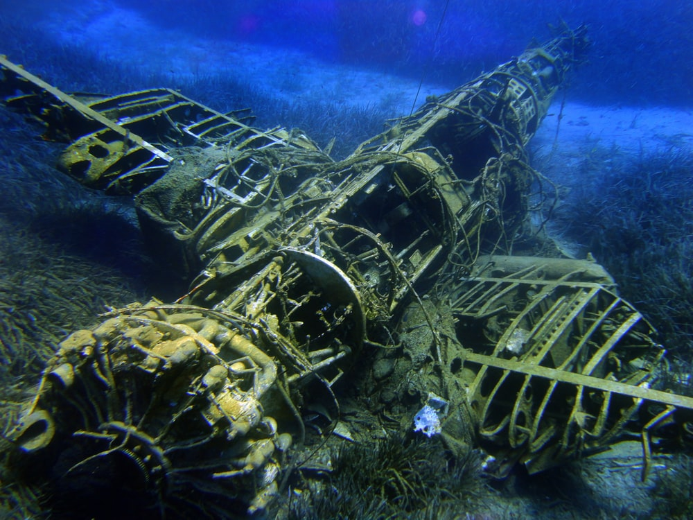 brown airplane under water