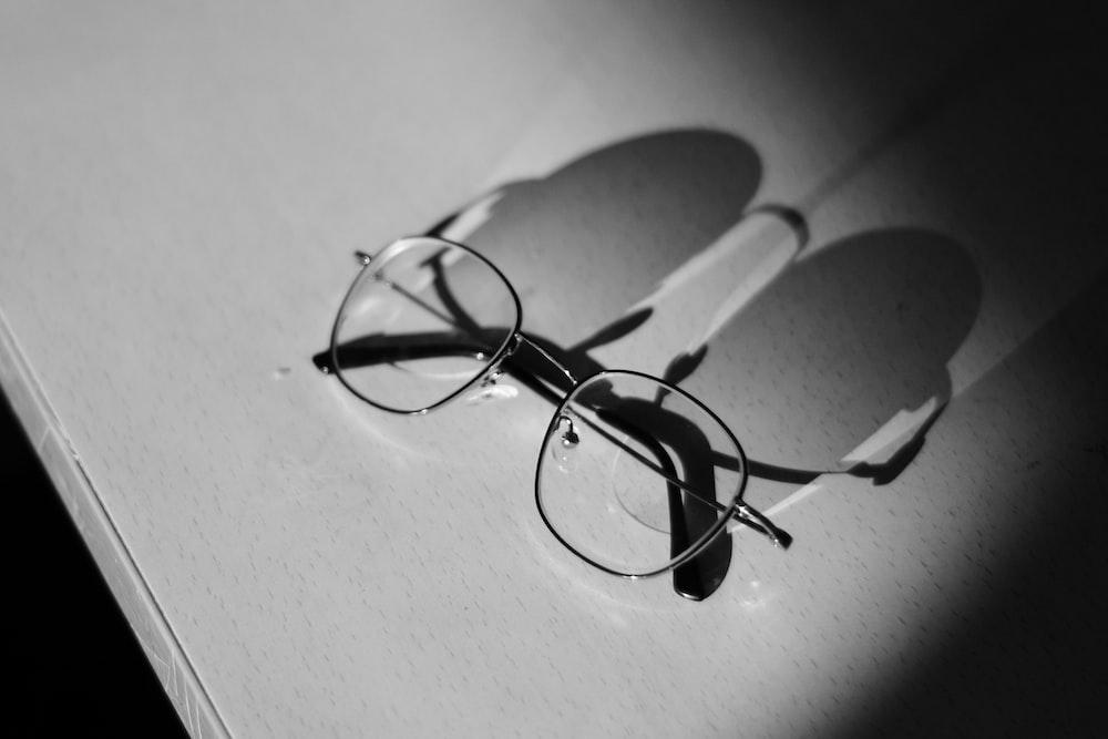 silver eyeglasses on table