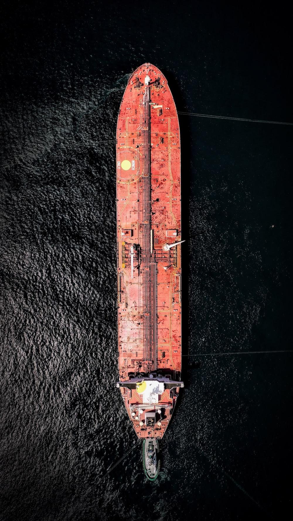 aerial photography of orange cargo ship on sea