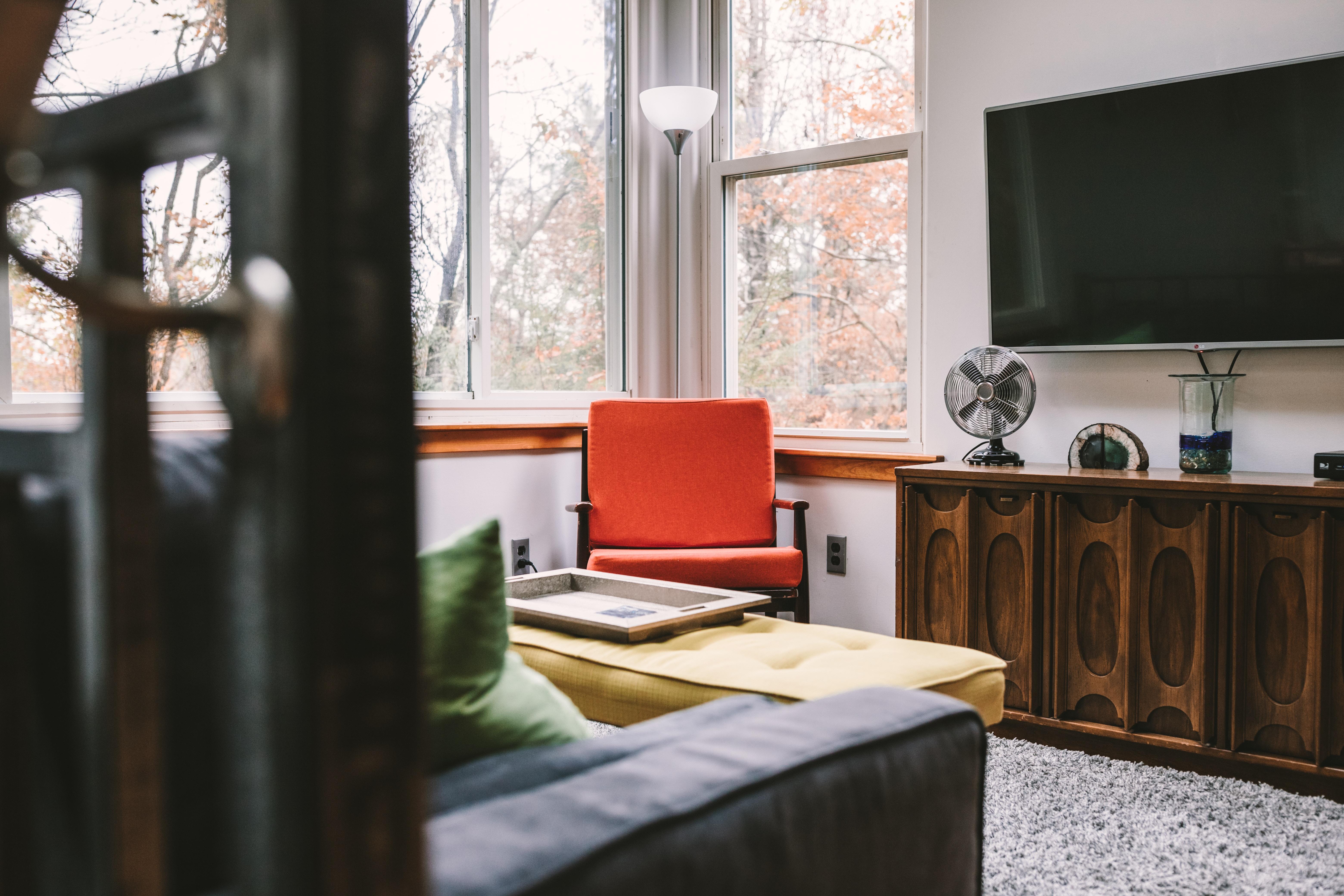 flat screen TV on white wall inside room
