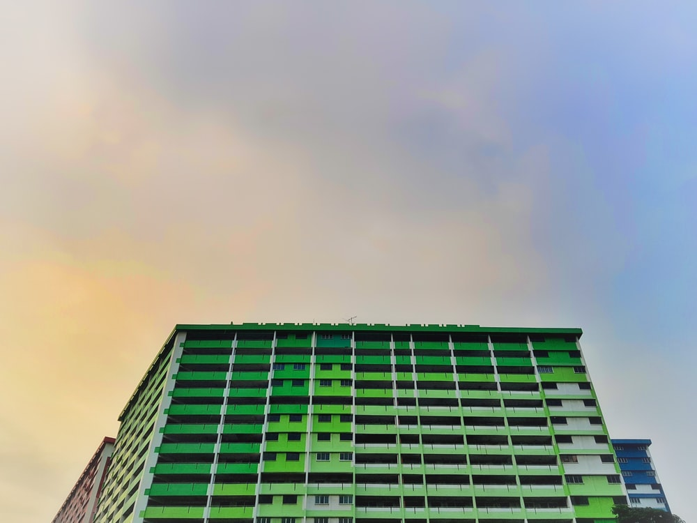 low-angle photo of green high-rise building