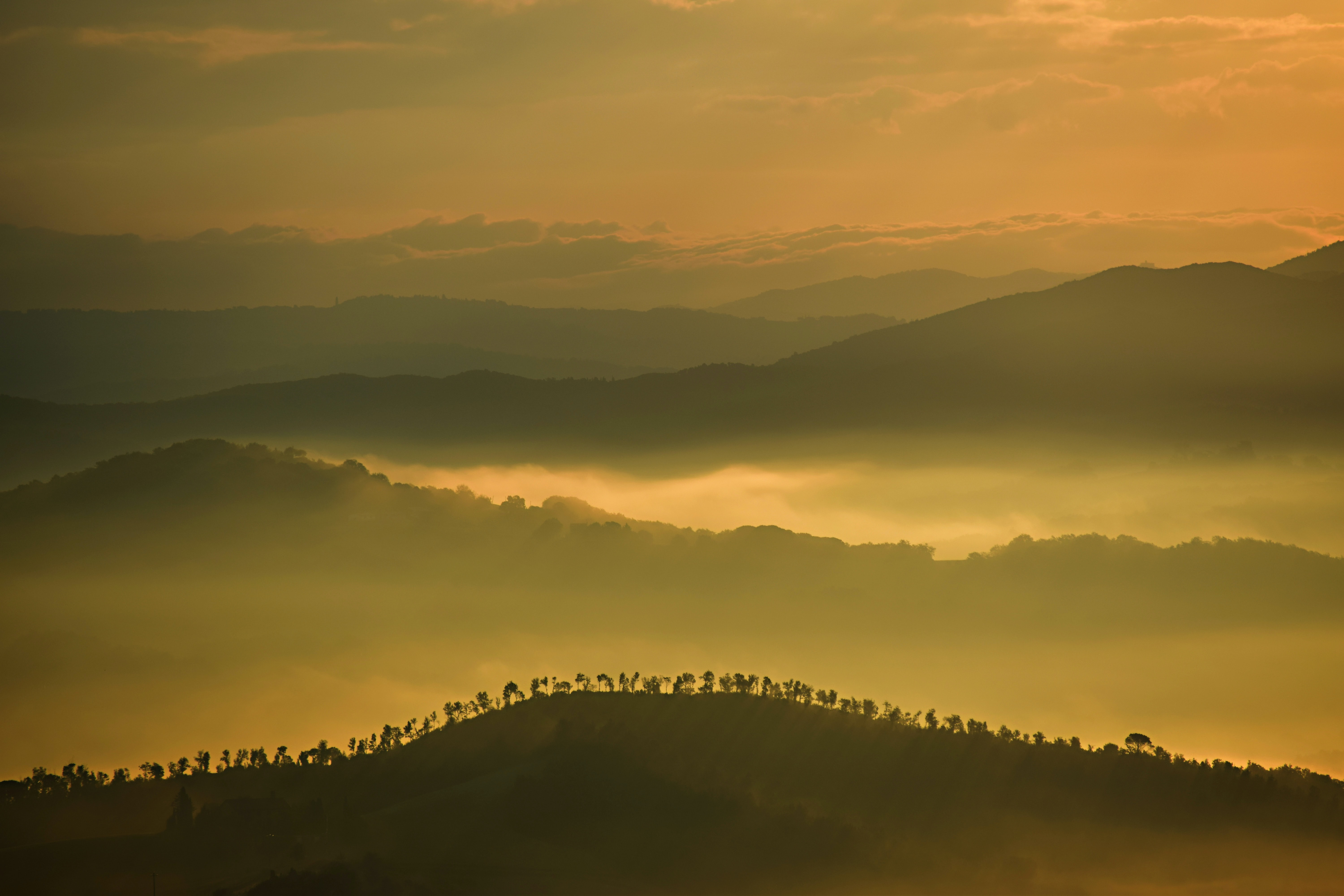mountain silhouette during cloudy sky