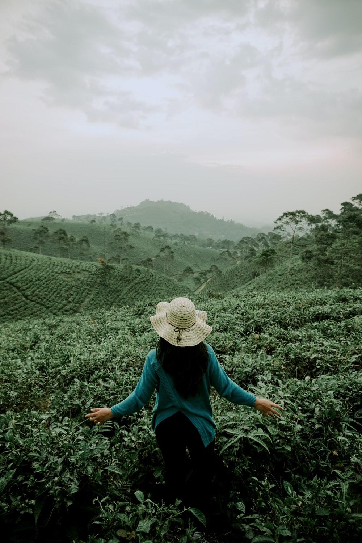 woman standing on green plants field