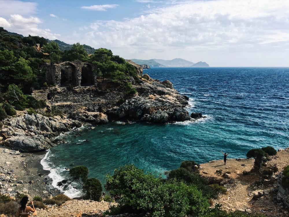 gray rocky mountain facing ocean