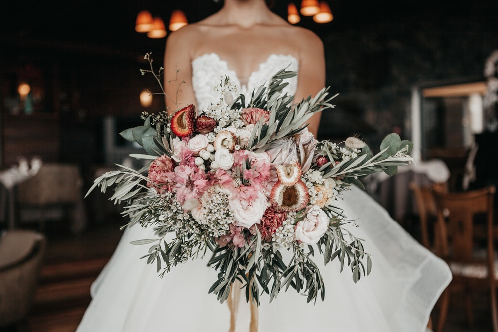 woman holding bouquet of flower