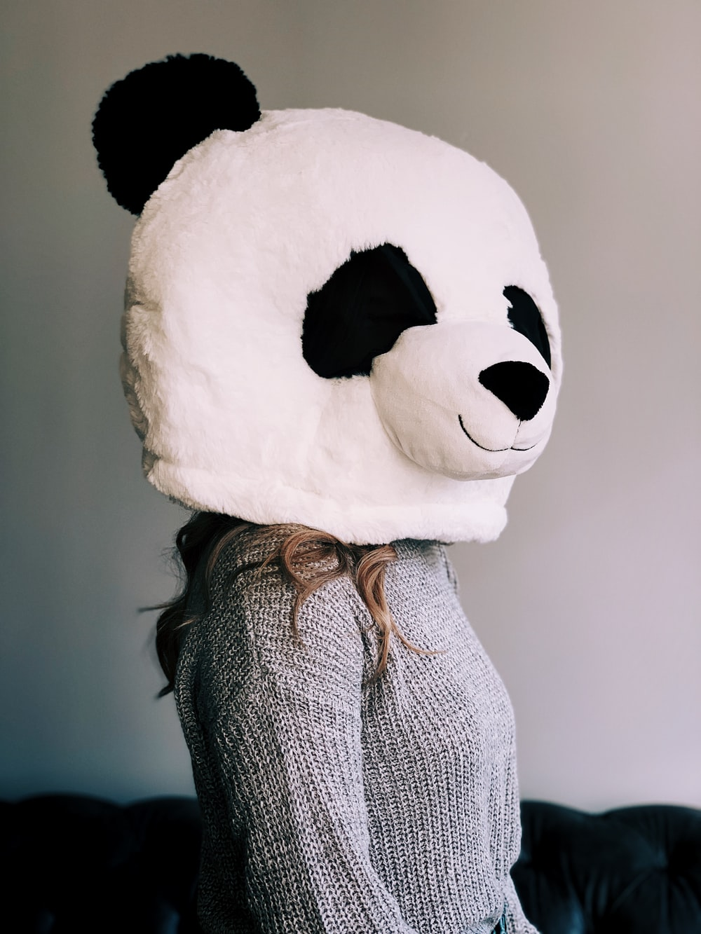 woman wearing panda head mascot