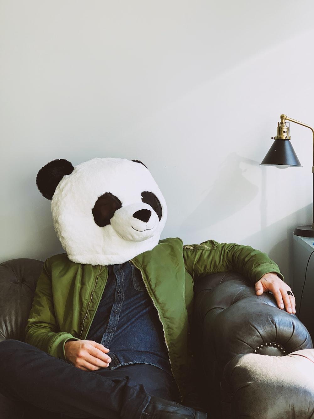person wearing panda costume head