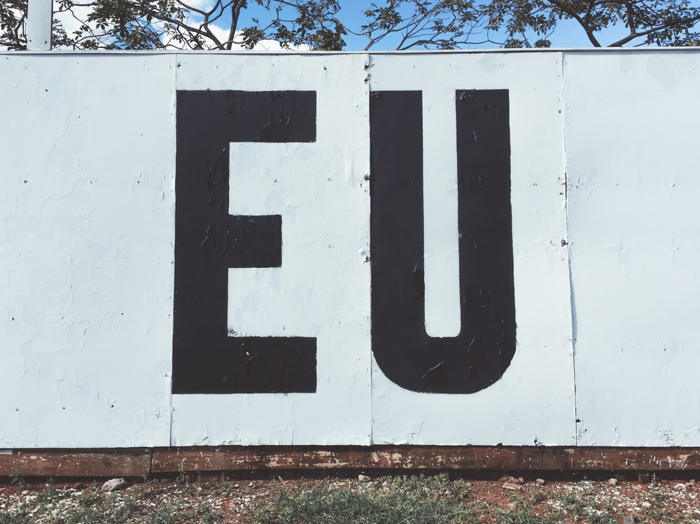 white and back EU painted wall during daytime