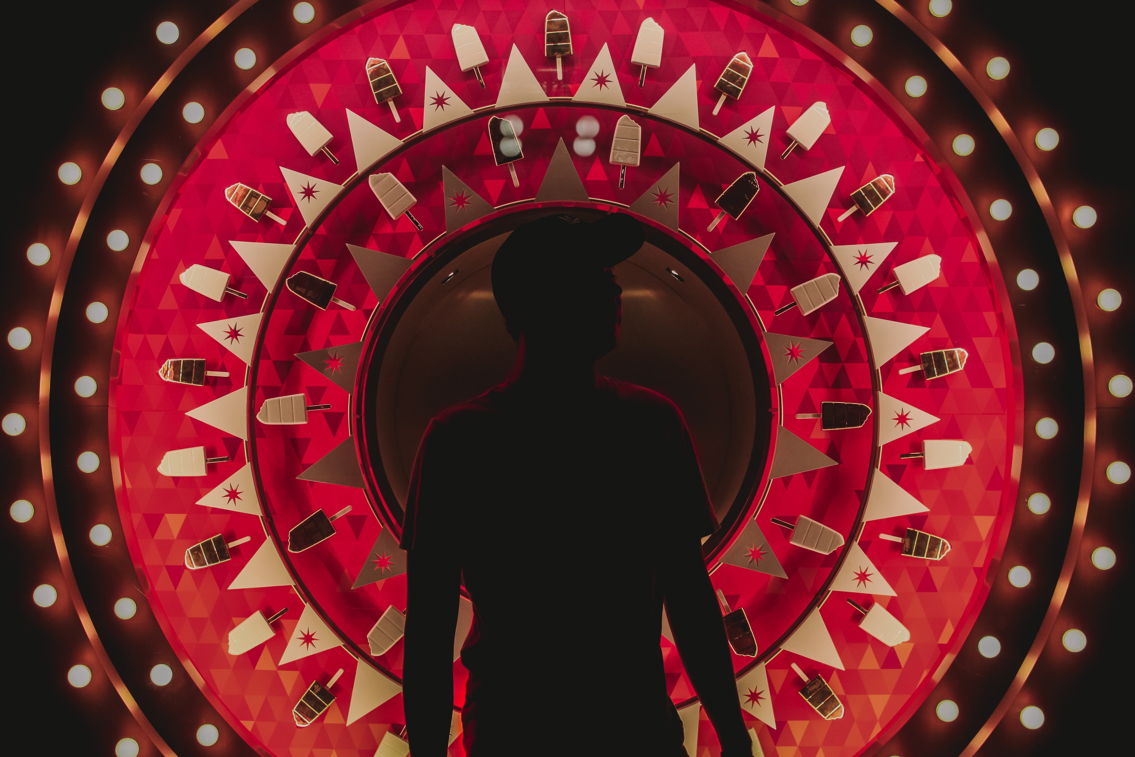 silhouette photography of man standing in front of wallpaper
