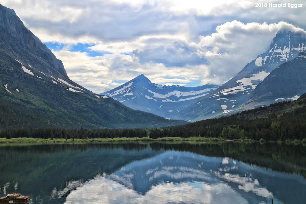view of lake through snowy mountain