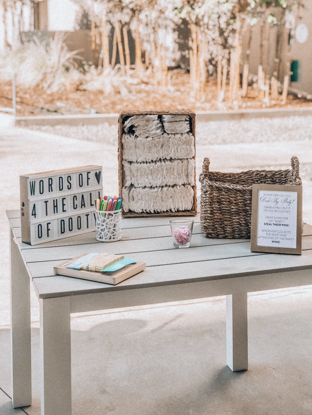 brown wicker basket on white wooden table