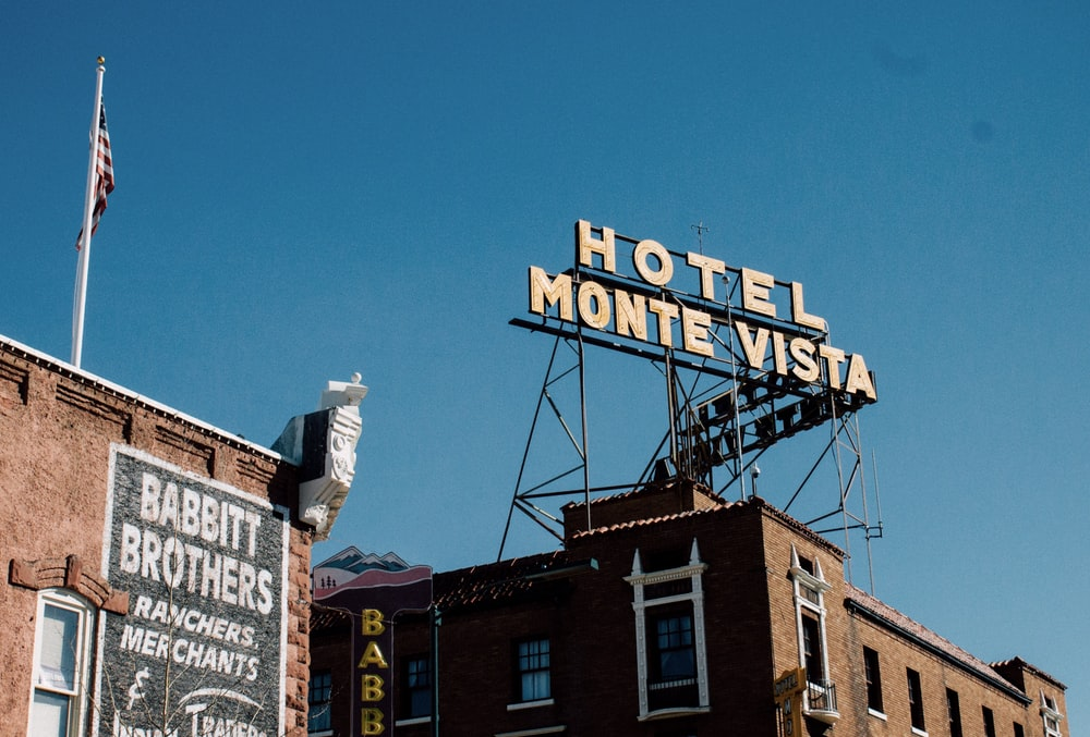Hotel Monte Vista sign on top of brown concrete building