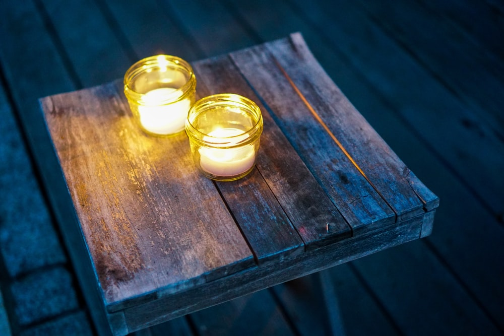 two lighted tealight candles