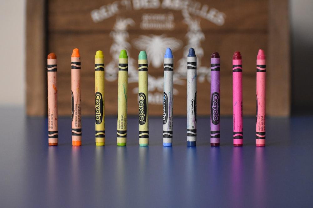 selective focus photography of Crayola crayons