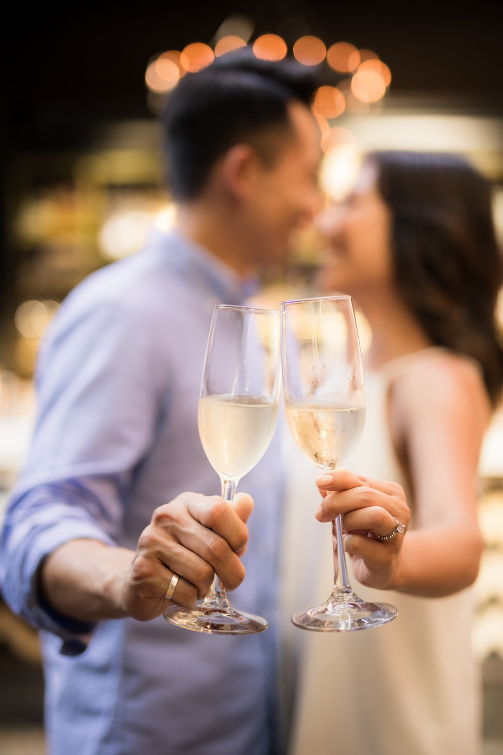 couple holding cocktail glasses