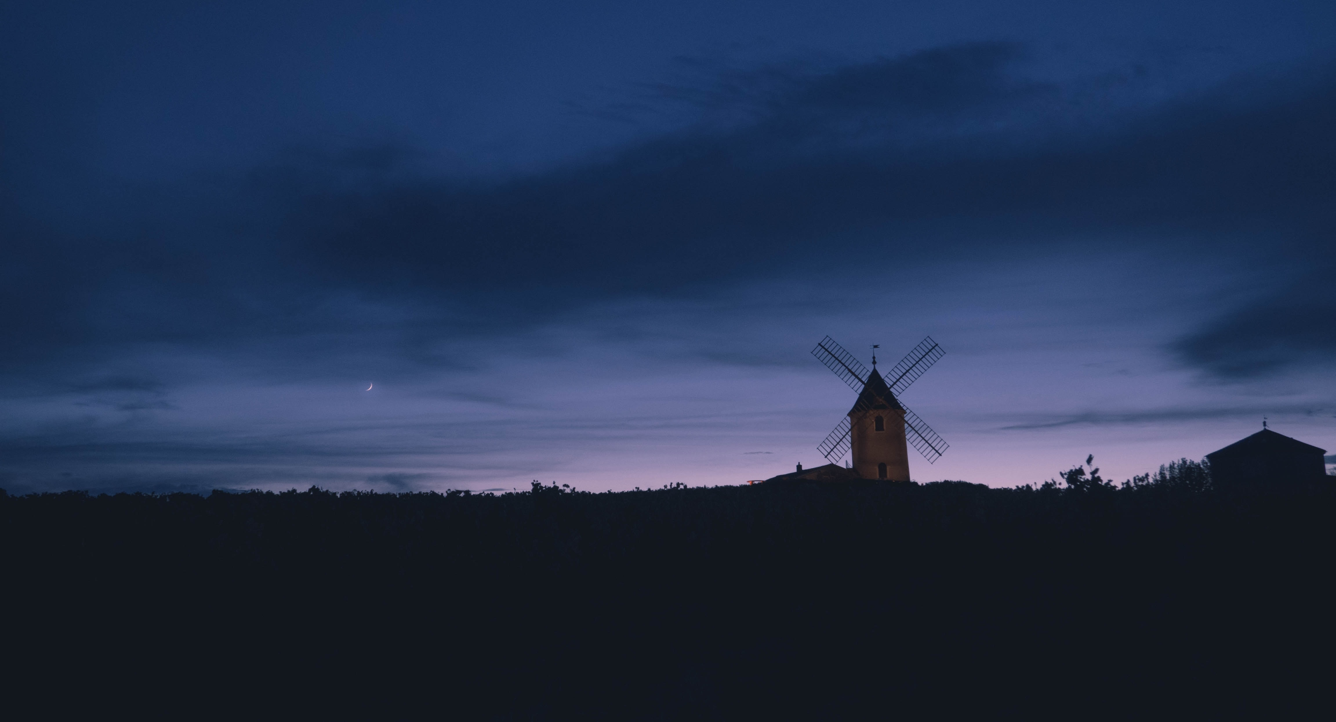 white windmill during sunset