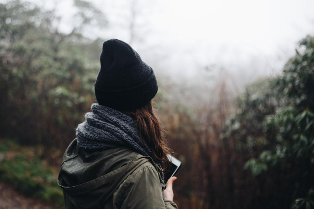 woman in black beanie hat and gray scarf